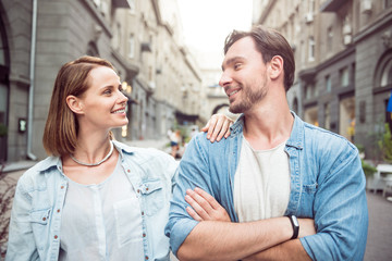 Pleasant couple standing in the street
