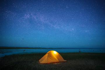 orange tent under starlight