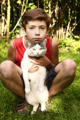 boy and cat outdoor photo