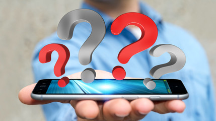 Businessman holding question marks over phone 3D rendering