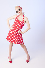 Pinup style full body portrait of a beautiful blond girl