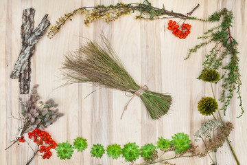 Dry flowers and herbs collage compoition at wooden desk