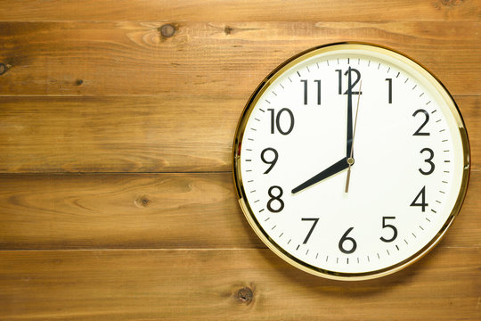 wall clock on the wooden wall
