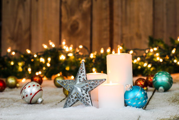 White candles with holiday decorations