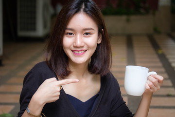 Portrait of thai adult glasses beautiful girl drinking coffee