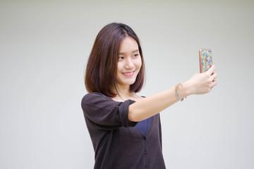 Portrait of thai adult student university beautiful girl using her smart phone Selfie