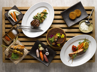 Japanese dinner set mezza with sushi, roasted beef, snapper, veg