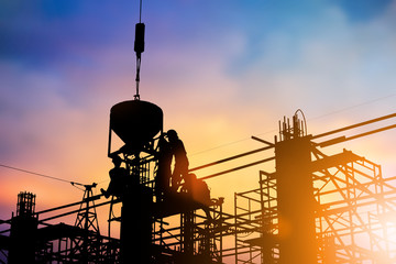 Silhouette of construction workers to work safely on a high with