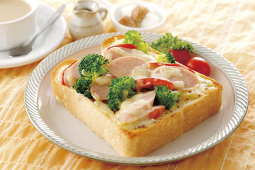 Mustard Mayo toast of fish sausage with broccoli and tea on whit