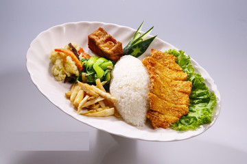 Crispy Chicken Rice with vegetable on white plate in white backg