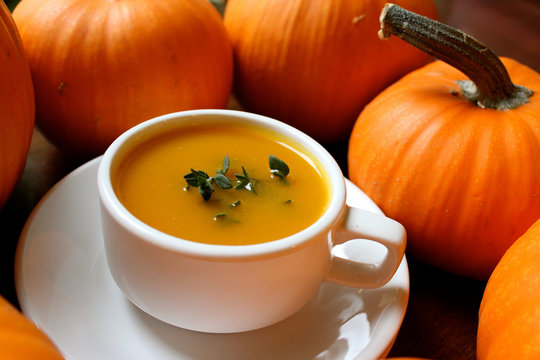 Pumpkin soup with potatoes and chestnuts in white cup