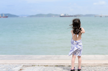 Young little girl near the sea