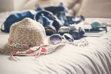 Full of things prepare to travel on holiday in bedroom