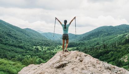 Happy hiker with trekking poles