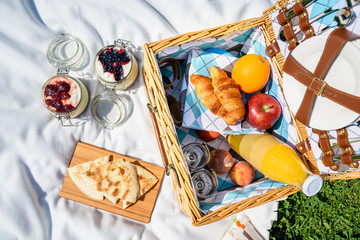 Picnic Basket With Fruits, Orange Juice, Croissants, Quesadilla And No Bake Blueberry And Strawberry Jam Cheesecake