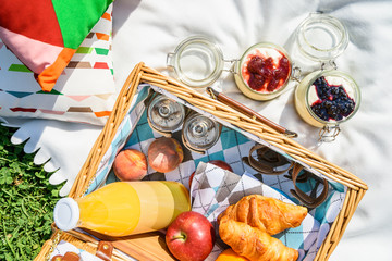 Picnic Basket With Fruits, Orange Juice, Croissants And No Bake Blueberry And Strawberry Jam Cheesecake