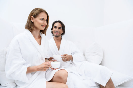 Mature couple relaxing together at day spa