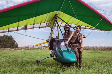 Ultralight aircraft and girl with the man.