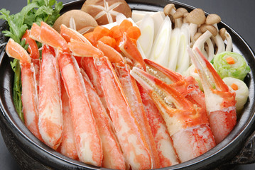 Raw fresh cold snow crab pot set with claws, legs, mushroom and