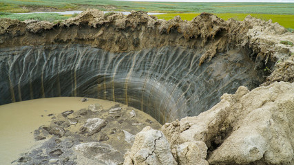 YAMAL PENINSULA, RUSSIA - JUNE 18, 2015: Expedition to the giant funnel of unknown origin. Crater view.