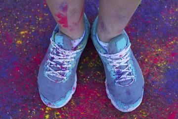 Female feet with dry powder staiding on asphalt