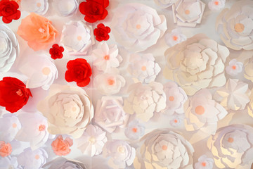 Beautiful wedding paper flowers for marriage. White decor for bride and groom. Colorful decoration for celebration. Beauty bridal interior