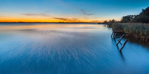 Wall Mural - Long exposure Sunset over Lake Schildmeer