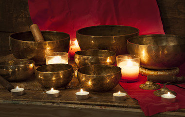 Tibetan singing bowls on red