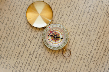 Old vintage compass on ancient map.