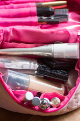 The inside of a girl's cosmetic bag