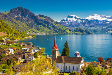 Famous boats on lake Lucerne in Weggis, Switzerland Wall mural
