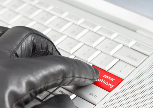 Spear phishing concept with hand wearing black leather glove pre