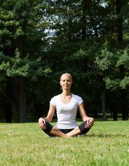 Beautiful woman doing yoga exercises