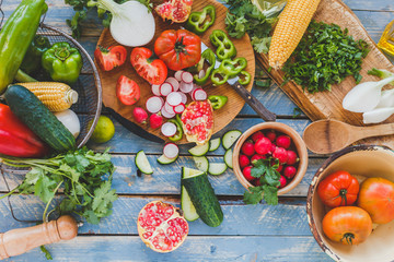 Fresh vegetables on the wooden table. Top view.