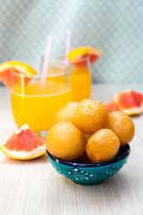 Sweet fried dough balls with honey
