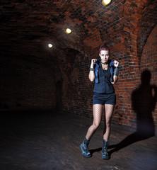 Poster Artist KB punk girl standing in the dark corridor