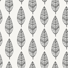 Seamless pattern with black feathers on white background.