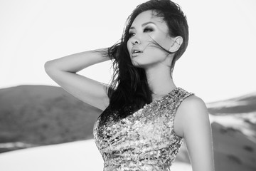 Beautiful sexy asian woman in desert. Black and white photo