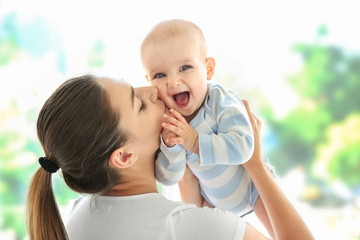 Mother and baby on light background