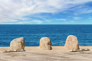 Boulders and empty parking spaces with scenic ocean view