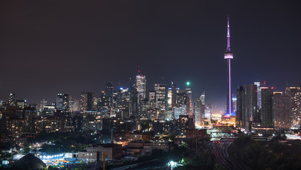 Urban lighted landscape of Toronto.   A balcony view of  lighted streets, parks, buildings and office towers on a hot & humid August night in capitol of Ontario, Canada.