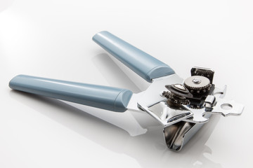 Can opener with blue handle on a white background
