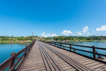 Wooden bridge over the river (Mon Bridge) in Sangkhlaburi District, Kanchanaburi, Thailand.