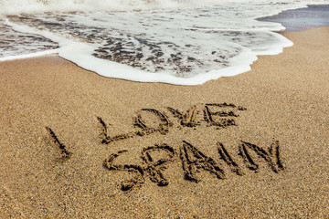 The words I Love Spain written in the sand on beach