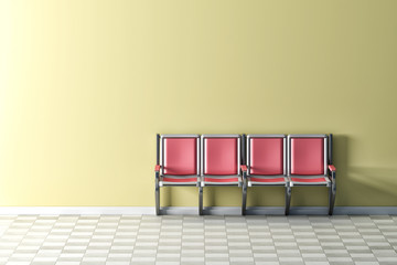 Pink seats on yellow wall