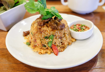 fried rice spicy tom yum sweet pork and chili with vegetable on