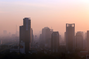 BANGKOK, THAILAND - December 15, 2015: beautiful foggy sunset ov