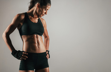 Tough woman with tight abdominal muscles