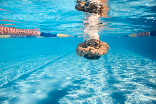 Swimmer in crawl style underwater
