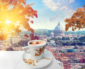 Cup of coffee in Rome with view of st Peters cathedral, Italy . Hot drink in autumn time. Colored vintage style picture